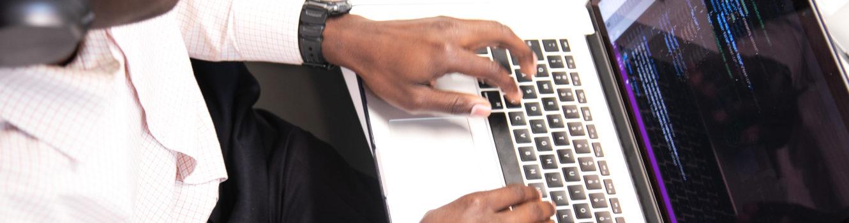 Developer typing at keyboard